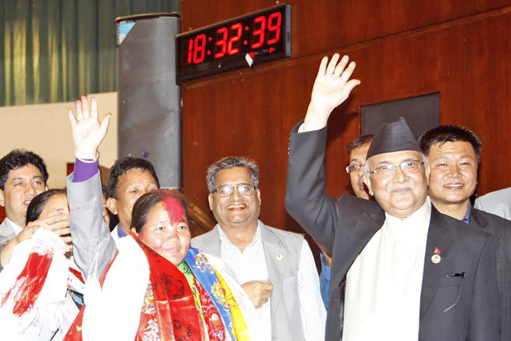 UCPN-Maoist lawmaker Onsari Gharti Magar (left), along with the PM, after being elected the first woman Speaker on Friday. Photo:THT