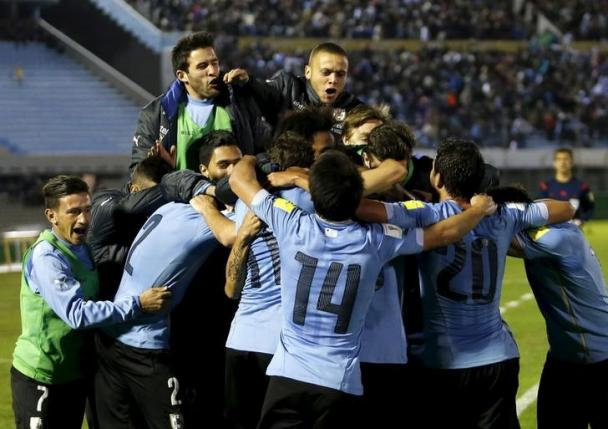 Uruguay's players celebrate after scoring a goal against Colombia during their 2018 World Cup qualifying soccer match at the Centenario stadium in Montevideo, Uruguay, October 13, 2015. REUTERS/Andres Stapff