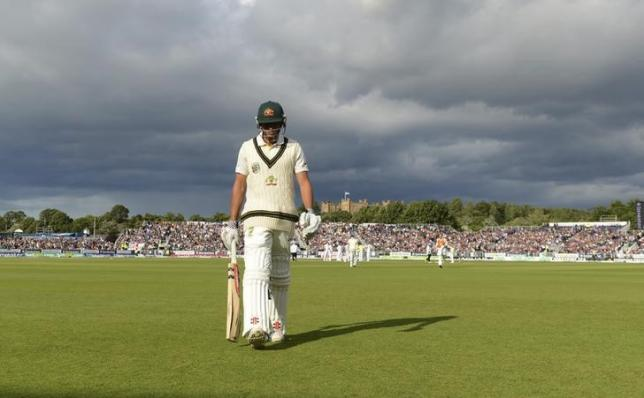Australia's Usman Khawaja leaves the field after being dismissed during the fourth Ashes cricket test match against England at the Riverside cricket ground in Chester-le-Street near Durham August 12, 2013. REUTERS/Philip Brown