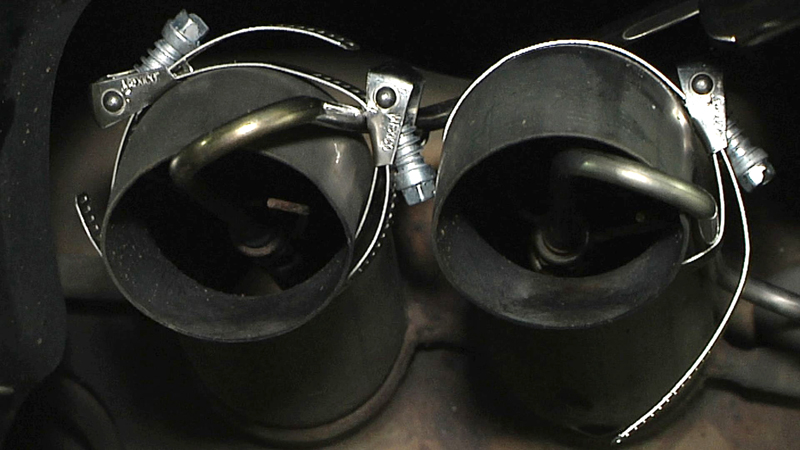 Clamps hold probes in the tailpipes of a 2010 Volkswagen Jetta TDI on the campus of North Carolina State University in Raleigh, N.C., on Monday, Sept. 28, 2015. The car belongs to environmental engineering student, who was allowing North Carolina State University engineering professor Chris Frey to test the car's emissions. Frey has been testing the VW diesels in real world conditions, driving more than 100 miles with monitors in the car tailpipes. He found pollution 10 times higher than the federal standard, and noticed that the worst pollution came as he got on to highways and in stop-and-go traffic. (AP Photo/Allen G. Breed)