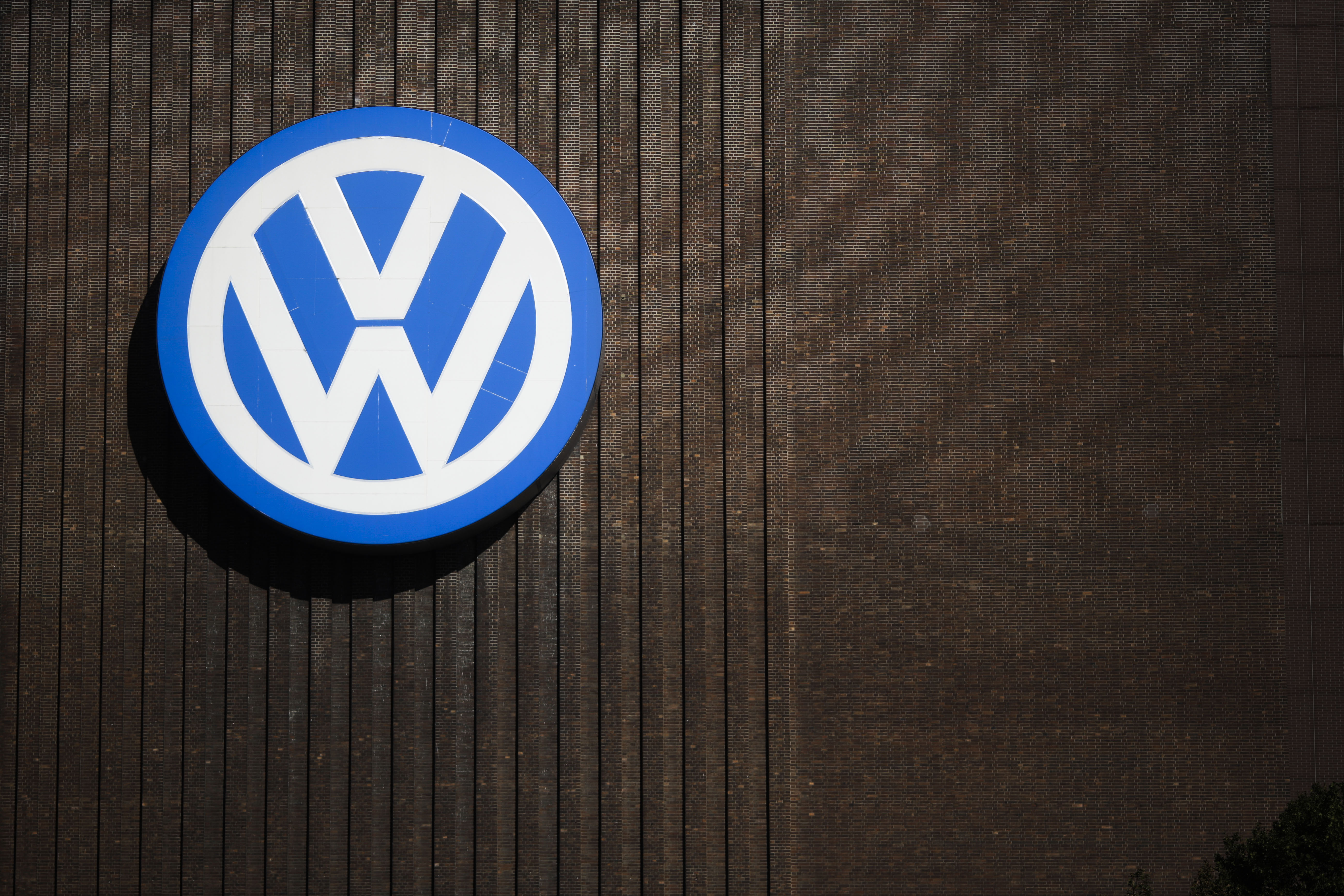 FILE - In this Sept. 29, 2015, file photo, a brand sign of the Volkswagen car company is seen at the car factory in Wolfsburg, Germany. More than a decade ago, the U.S. Environmental Protection Agency helped develop a technology that ultimately allowed an independent laboratory to catch Volkswagenu0092s elaborate cheating on car emissions tests. But EPA did not apply that technology on its own tests of diesel passenger cars and instead focused on trucks,thus missing its best chance to foil the German carmakeru0092s deception as early as 2007. (AP Photo/Markus Schreiber, File)