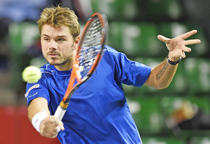 Stan Wawrinka of Switzerland returns to Tatsuma Ito of Japan during their second round match at the Japan Open in Tokyo on Wednesday. Wawrinka won the match 6-3, 2-6, 6-4. Photo: AFP