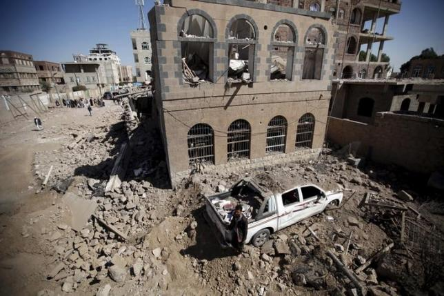A man stands at the site of Saudi-led air strikes in Yemen's capital Sanaa October 28, 2015. Photo: Reuters