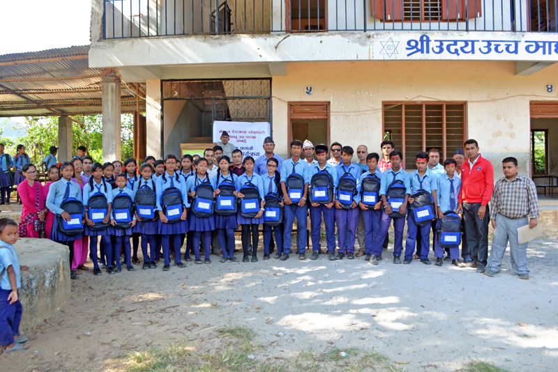 Students pose for a group photo in the premises of Uday Higher Secondary School at Dhulotar-8, Byas in Tanauhn district after receiving school bags and study materials from Japanese students on Friday, October 09, 2015. Photo: Madan Wagle