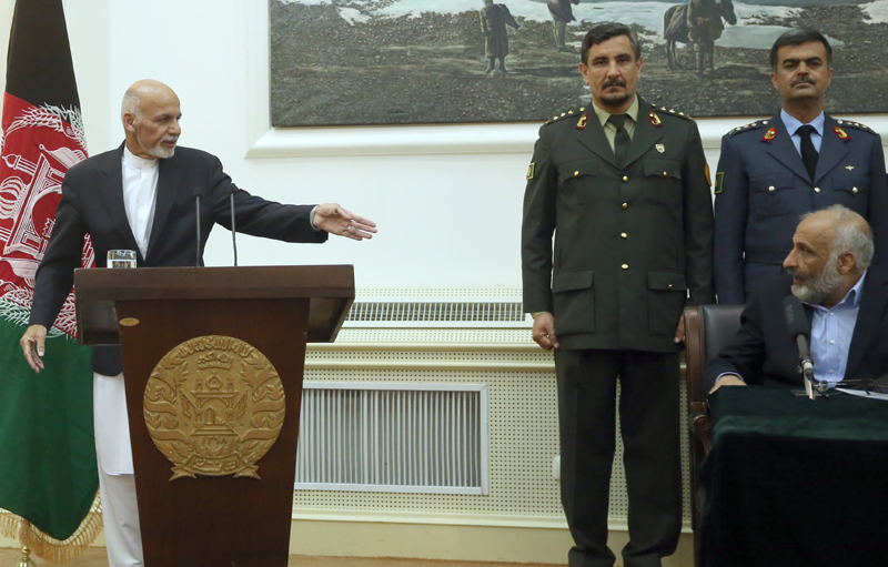 Afghan President Ashraf Ghani, left, points Afghanistan's acting defense minister Masoom Stanikzai, sitting, during a press conference at presidential palace in Kabul, Afghanistan, Tuesday, Sept. 29, 2015. Taliban gunmen fanned out in full force Tuesday across a key Afghan city they captured the day before, as the U.S. military carried out an airstrike on Kunduz and President Ashraf Ghani vowed to take the northern city back from the insurgents, urging his nation to trust Afghan troops to do the job. Photo: AP