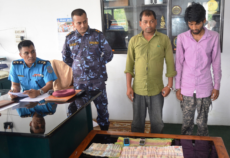 Police making the two suspects, arrested with fake Indian currencies, public in Birgunj on Wednesday, October 21, 2015. Photo: Ram Sarraf/ THT