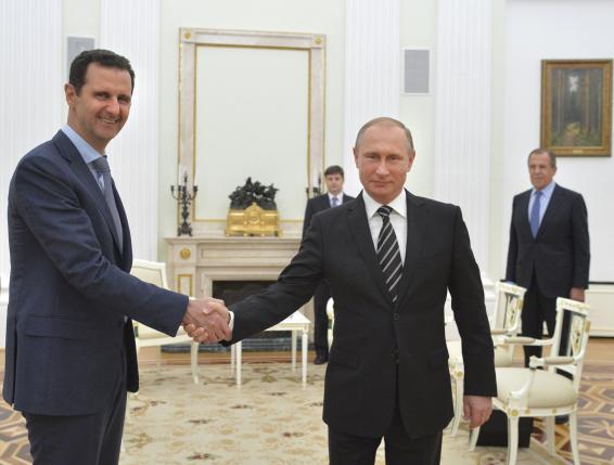 Russian President Vladimir Putin shakes hands with Syrian President Bashar al-Assad during a meeting at the Kremlin in Moscow, Russia, October 20, 2015.  REUTERS/Alexei Druzhinin/RIA Novosti/Kremlin