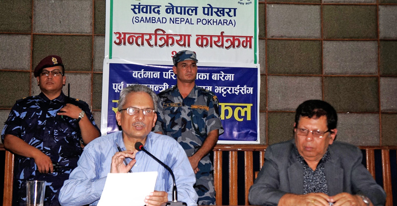 Former prime minister Babu Ram Bhattrai speaks during the interaction programme in Pokhara on Thursday, October 15, 2015. Photo: Bharat Koirala