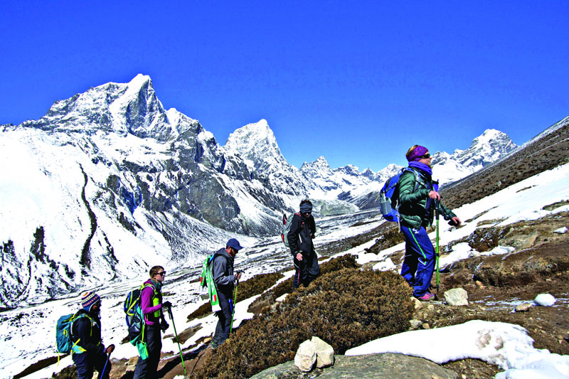 FILE - In this March 18, 2015 file photo, trekkers take an acclimatisation hike to Nagarzhang peak above Dingboche valley on the way to Everest base camp, Nepal. Photo: AP