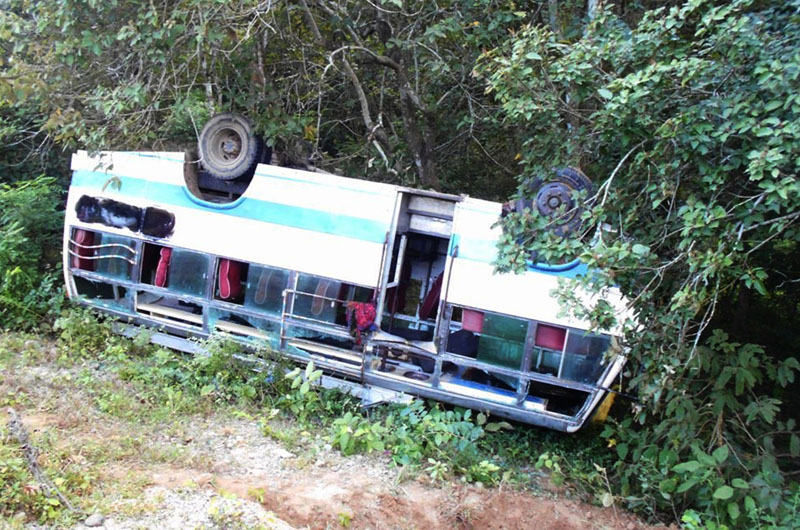 Bus (Ma 1 kha 456) that flipped near Basanta Community Forest in Jhalari Pipladi Municipality-11 of kanchanpur district injuring seven passengers on Monday, October 05, 2015. Photo: RSS