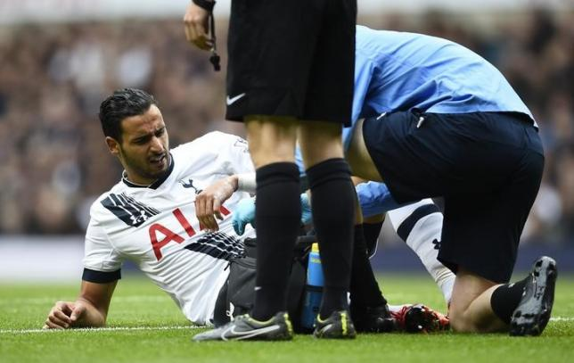 Tottenham's Nacer Chadli receives treatment after sustaining an injury. Reuters / Dylan MartineznLivepic