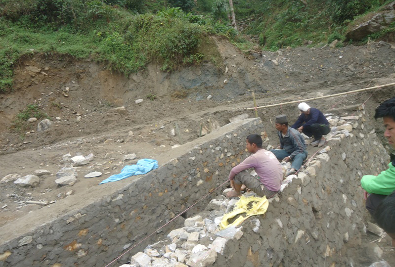 Labourers work at a point of the Mid-Hill Highway in Panchthar, on Saturday, October 31, 2015. Owing to shortage of fuel, development works have been adversely affected across the nation. Photo: Laxmi Gautam
