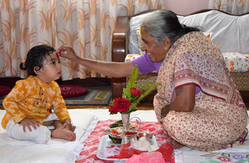 Seventy-five-year-old Gayatri Sharma gives Dashain Tika to her two-year-old grandson Adwait at their residence in Chabahilu201a Kathmandu on Fridayu201a October 3u201a 2014. Photo: THT Online/File