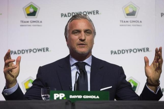 Former footballer David Ginola from France speaks at a press conference where he announced his campaign to stand for the FIFA presidency in London, January 16, 2015.  REUTERS/Neil Hall