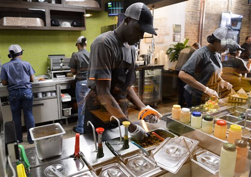 Employees prepare food at the new Taco Bell Cantina restaurant in Chicago. The Labor Department releases the employment cost index for the third quarter, a measure of wage and benefit growth on September 22, 2015. Photo: AP