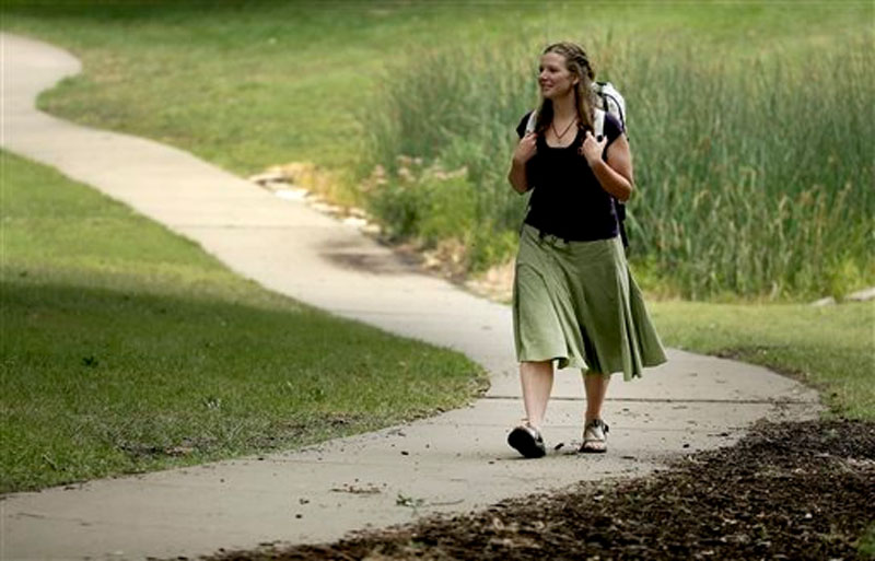 Bethany Hughes walks through a park in Kansas City, Mo. as she prepares for her upcoming hike through the Americas on August 28, 2015. Photo: AP