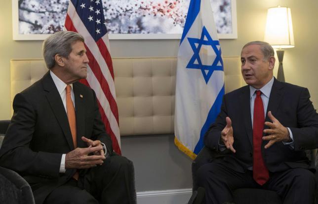 U.S. Secretary of State John Kerry (L) speaks with Israeli Prime Minister Benjamin Netanyahu during a meeting in New York, October 2, 2015. REUTERS/Kena Betancur/Pool