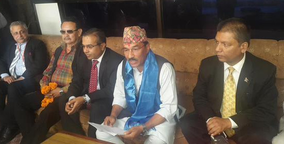 Deputy Prime Minister Kamal Thapa talks with journalists before leaving for New Delhi on a three-day official visit, at the Tribhuvan International Airport on Saturday, October 17, 2015. Courtesy: Mohan Shrestha