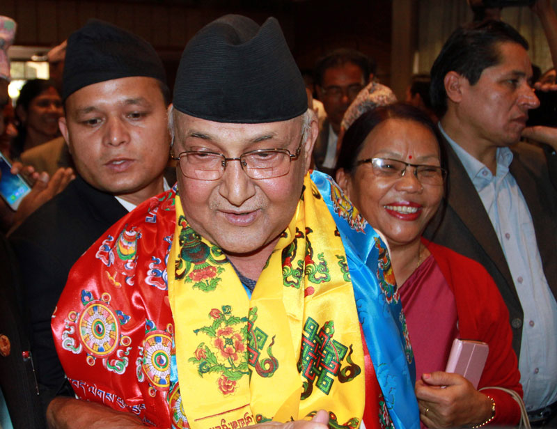 CPN-UML Chairman KP Sharma Oli speaks to media after filing his nomination for the Prime Minister's election, at the Parliament building, on Saturday, October 10, 2015. Photo: RSS