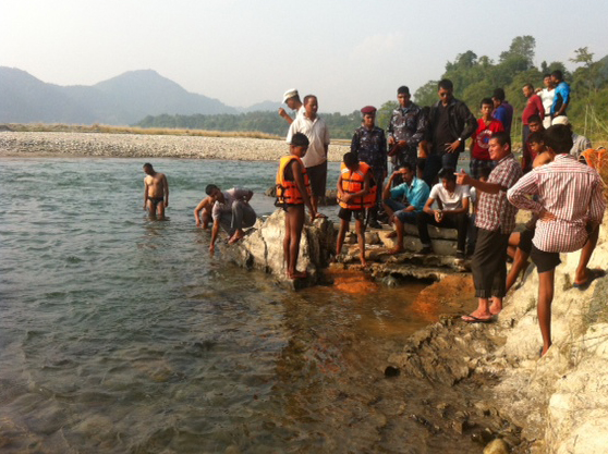 Locals and police searching for two youth, who were missing in the Madi River, in Damauli of Tanahun, on Sunday, October 25, 2015. Photo: Madan Wagle