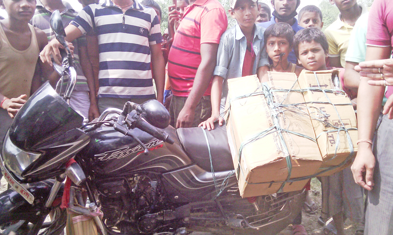 Locals protesting police 'brutality' take a motorbike carrying medicine under control at Pathara of Jhunkhunawa,  Saptari, on Sunday.  Photo: THT