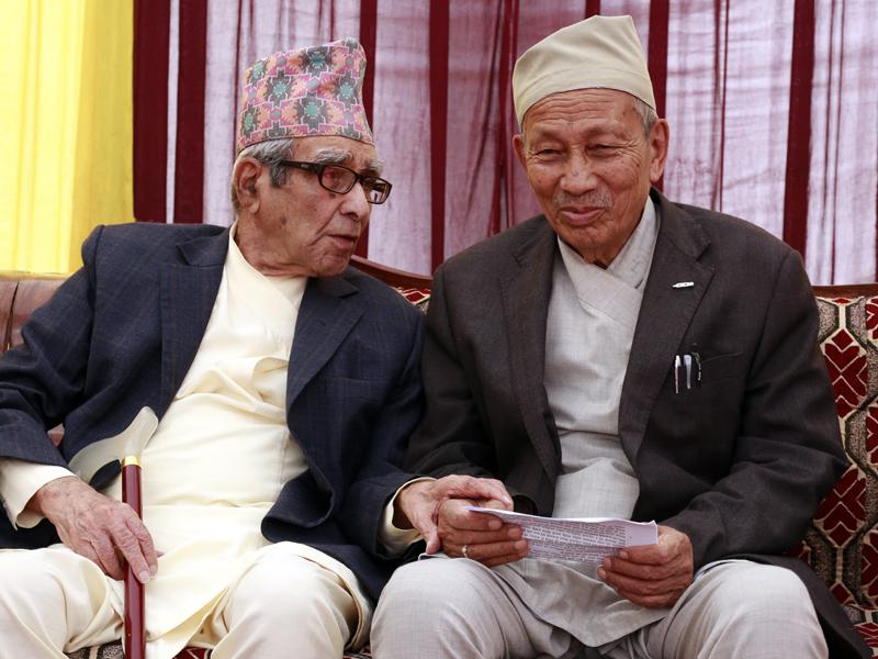 Rastrakavi Madav Prasad Ghimire (left) and veteran cultural expert Satya Mohan Joshi talk at a function organised in Kathmandu, on Sunday, October 11, 2015. Photo: RSS