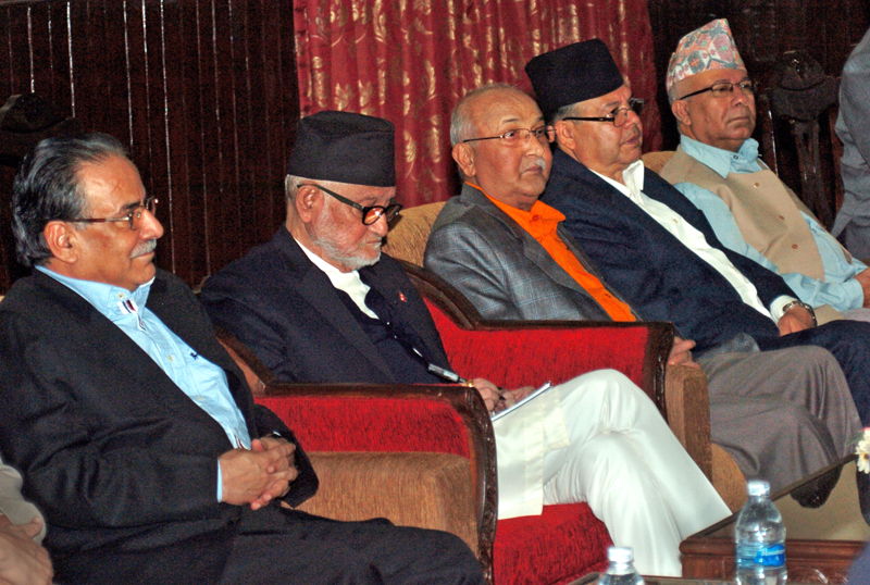 Prime Minister Sushil Koirala (second from left) updating his notes before addressing an all-party meeting called by him at his official residence in Baluwatar, Kathmandu, on Monday. Photo: THT
