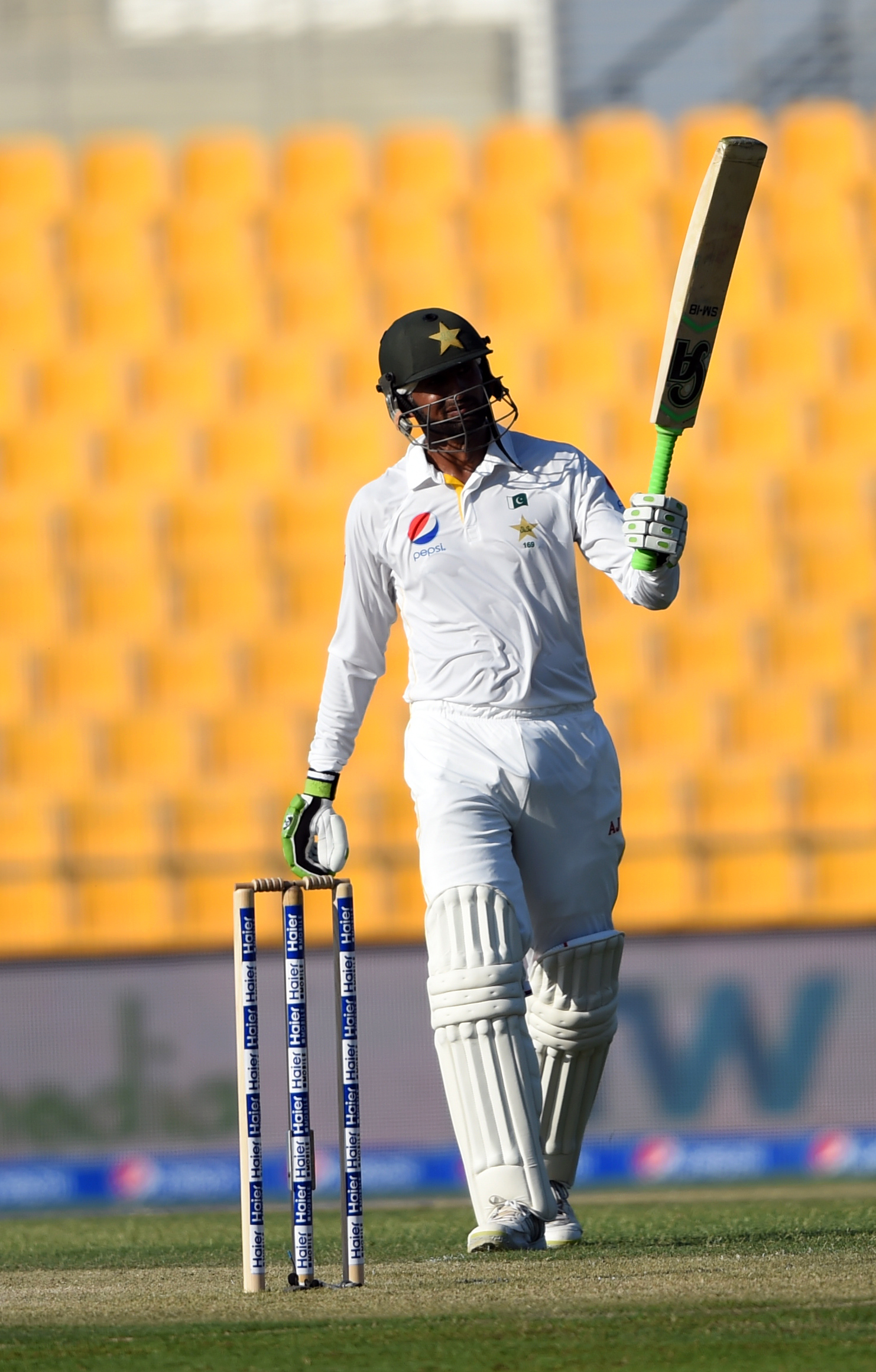 Pakistan batsman Shoaib Malik celebrates his century against England during first day of first test match at Zayed Cricket Stadium in Abu Dhabi, United Arab Emirates, Tuesday, Oct. 13, 2015. (AP Photo/Hafsal Ahmed)