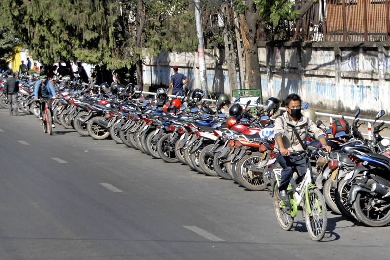 With fuel in short supply and long queues outside petrol stations becoming a norm, the Valley denizens have taken to riding bicycles to commute within the Kathmandu Valley as is seen in this photo clicked in Lalitpur, on Thursday. Photo: Bal Krishna Thapa/ THT