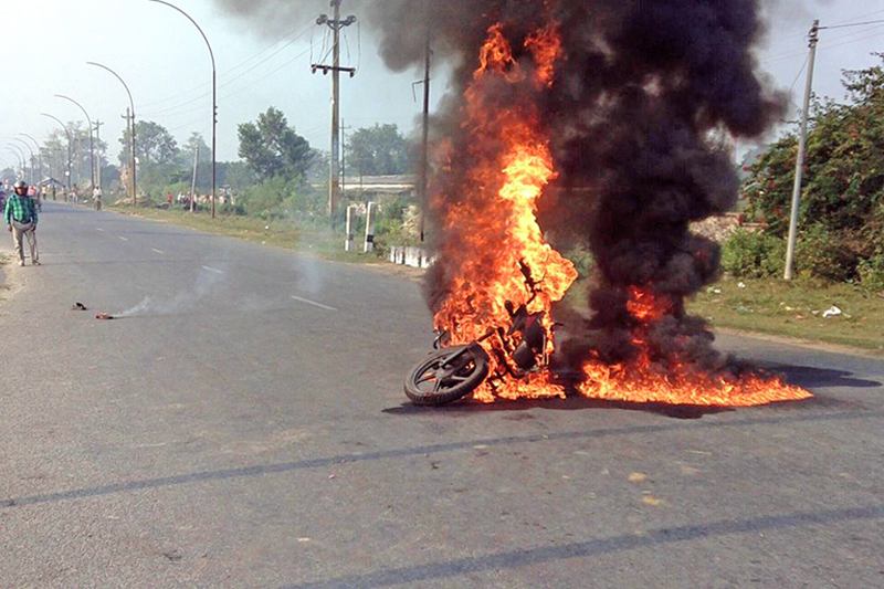 A motorcycle torched by the cadres of United Democratic Madhesi Front (UDMF) in Pipara Road of Birgunj on Sunday, October 25, 2015. Photo: Ram Sarraf/ THT