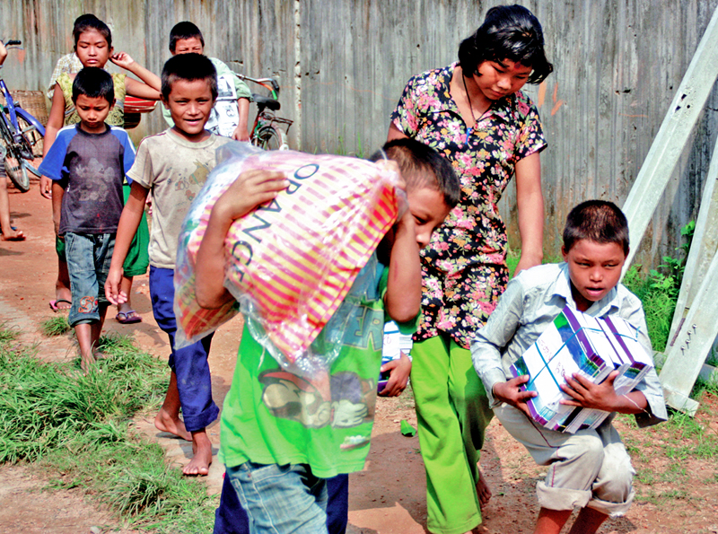 Chepang children heading home after receiving educational material provided by Lions Club in Ratnagar, Chitwan, on Friday, October 02, 2015. Photo: THT