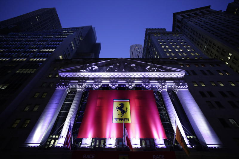 The front of the New York Stock Exchange is decorated with a Ferrari banner in honor of Ferrari's IPO, Wednesday, Oct. 21, 2015. Photo: AP