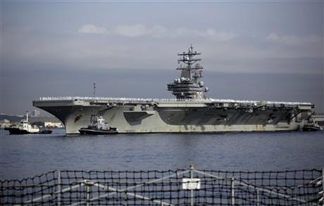 US navy nuclear-powered aircraft carrier USS Ronald Reagan arrives at the US Navy's Yokosuka base in Yokosuka, near Tokyo Thursday, Oct. 1, 2015. USS Ronald Reagan has entered its new home in Japan's Yokosuka naval port, replacing its predecessor USS George Washington. The arrival Thursday comes just as Tokyo tries to deepen defense ties with the US under new security law. Photo: AP