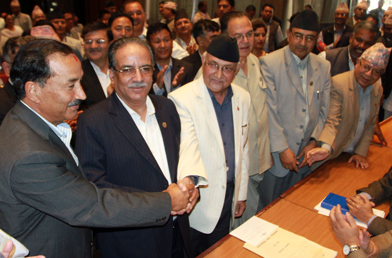 File- CPN-UML Chairman KP Sharma Oli (third from left) shakes hand with UCPN-Maoist Chairman Pushpa Kamal Dahal (second from left) and Rastriya Prajatantra Party-Nepal Chairman Kamal Thapa as he filed nomination for the PM election, proposed by Dahal and supported by Thapa, in Kathmandu, on Saturday, October 10, 2015. RSS