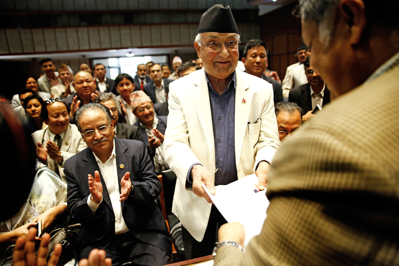 CPN-UML Chairman KP Sharma Oli filing his nomination for the PM election at the Parliament building in New nBaneshwor, Kathmandu, on Saturday. Photo: THT
