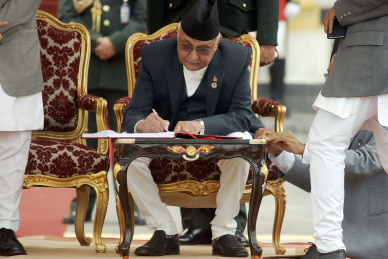 Prime Minister KP Sharma Oli signs the transcript of his oath of office and secrecy at the swearing-in ceremony, in Kathmandu, on Monday, October 12, 2015. Photo: Bal Krishna Thapa/THT