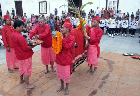 Priests worshiping the Phulpati brought from Gorkha at the Dashainghar of Nasal Chowku0082 Hanumandhokau0082 on Wednesdayu0082 October 1u0082 2014. Photo: RSS
