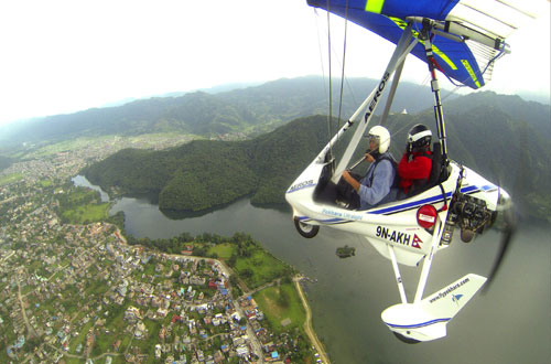 Tourists sightsee Pokhara city and Annapurna mountain range from ultralight aircraft in Pokhara in July 2013. Photo: THT/File.