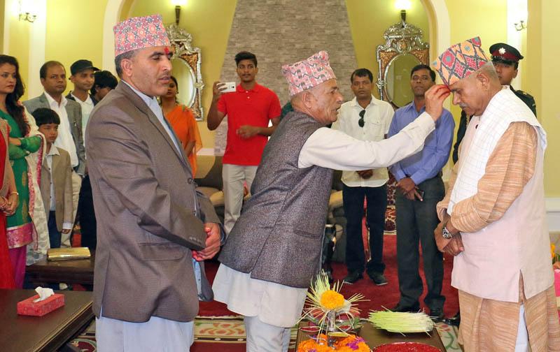 President Dr Ram Baran Yadav receives Dashain Tika from a priest at Sheetal Niwas, Photo: RSS