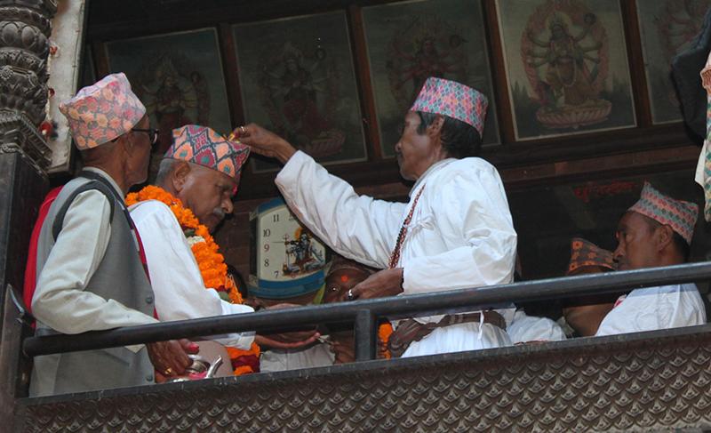 President Ram Baran Yadav receices Tika and Prasad from the priest of Navadurga temple in Bhaktapur, on the day of Kojagrat Purnima, on Monday, October 26, 2015. Photo: RSS
