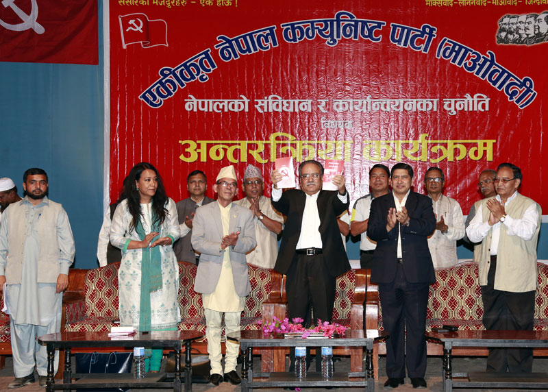 UCPN-Maoist Chairman Pushpa Kamal Dahal (centre) at an interaction organised by the party, in Kathmandu, on Sunday, October 4, 2015. Photo: RSS