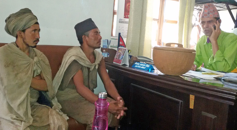 Two members of tribal Raute community, who arrived in Chitwan in the run-up of the Dashain festival, call on Chitwan Chief District Officer Binod Prakash Singh, in Bharatpur on Wednesday, October 14, 2015. Photo: Tilak Ram Rimal