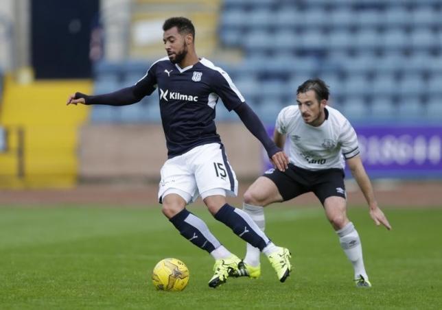 Everton's Leighton Baines and Dundee's Kane HemmingsnMandatory Credit: Action Images / Graham Stuart