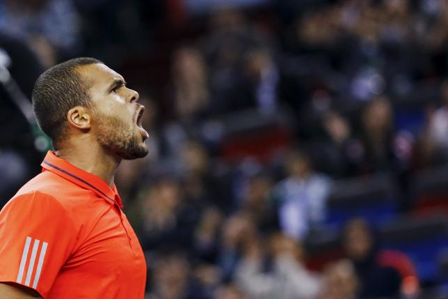 Jo-Wilfried Tsonga of France celebrates a point against Rafael Nadal of Spain in the last game of their men's singles semi-final match at the Shanghai Masters tennis tournament in Shanghai, China, October 17, 2015. REUTERS/Damir Sagolj