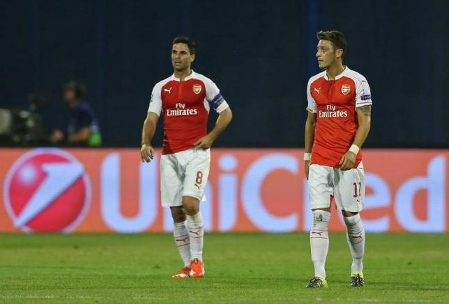 Football - Dinamo Zagreb v Arsenal - UEFA Champions League Group Stage - Group F - Maksimir Stadium, Zagreb, Croatia - 16/9/15nArsenal's Mikel Arteta and Mesut Ozil look dejected after Zagreb's first goalnAction Images via Reuters / Matthew ChildsnLivepic