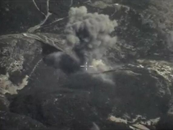 A frame grab taken from footage released by Russia's Defence Ministry October 4, 2015, shows what Russia says is smoke rising after airstrikes carried out by the Russian air force on the Islamic State near Jisr al-Shughour in Idlib province, Syria. Photo:  REUTERS