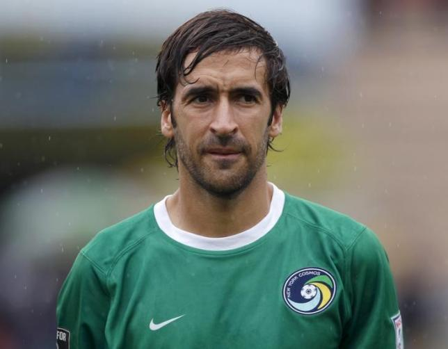 New York Cosmos player Raul Gonzalez listens as the Cuban national anthem is played before a friendly game against Cuba's national soccer team in Havana June 2, 2015. Photo: REUTERS