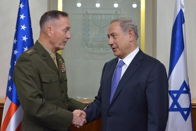 Israel's Prime Minister Benjamin Netanyahu (R) shakes hands with US Chairman of the Joint Chiefs of Staff Joseph Dunford during a meeting in Jerusalem in this October 18, 2015 handout photo by Israel's Government Press Office. Photo: REUTERS
