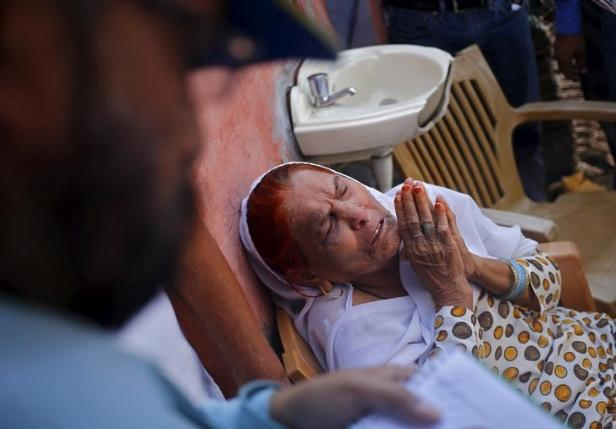 Asgari Begum, mother of Akhalaq Saifi, who was killed by a mob, mourns his death inside her house at Bisara village in Uttar Pradesh, India, October 2, 2015.  Photo: REUTERS