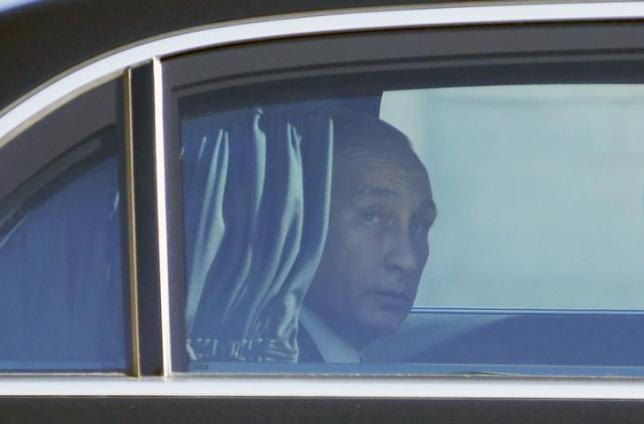 Russia's President Vladimir Putin arrives to attend a summit to discuss the conflict in Ukraine at the Elysee Palace in Paris, France, October 2, 2015.  PHOTO: REUTERS